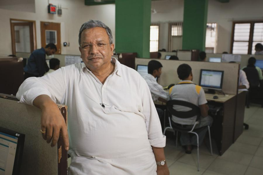 The Men Who Made Microfinance Work