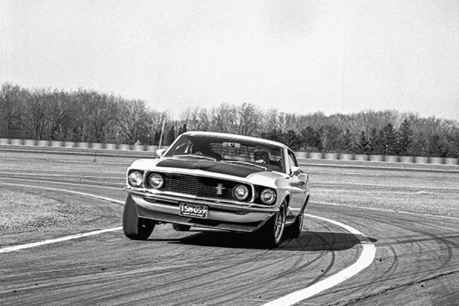 A 1969 Boss 302 being put through its paces on a race track